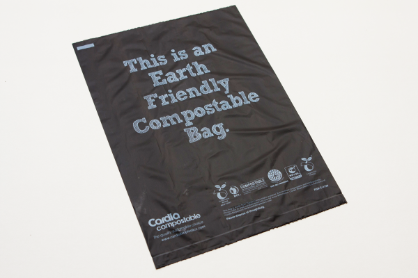 Black Cardia compostable, earth friendly dog waste bag laid out flat