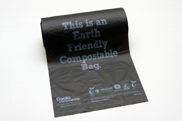Black Cardia compostable, earth friendly dog waste bag partially unrolled